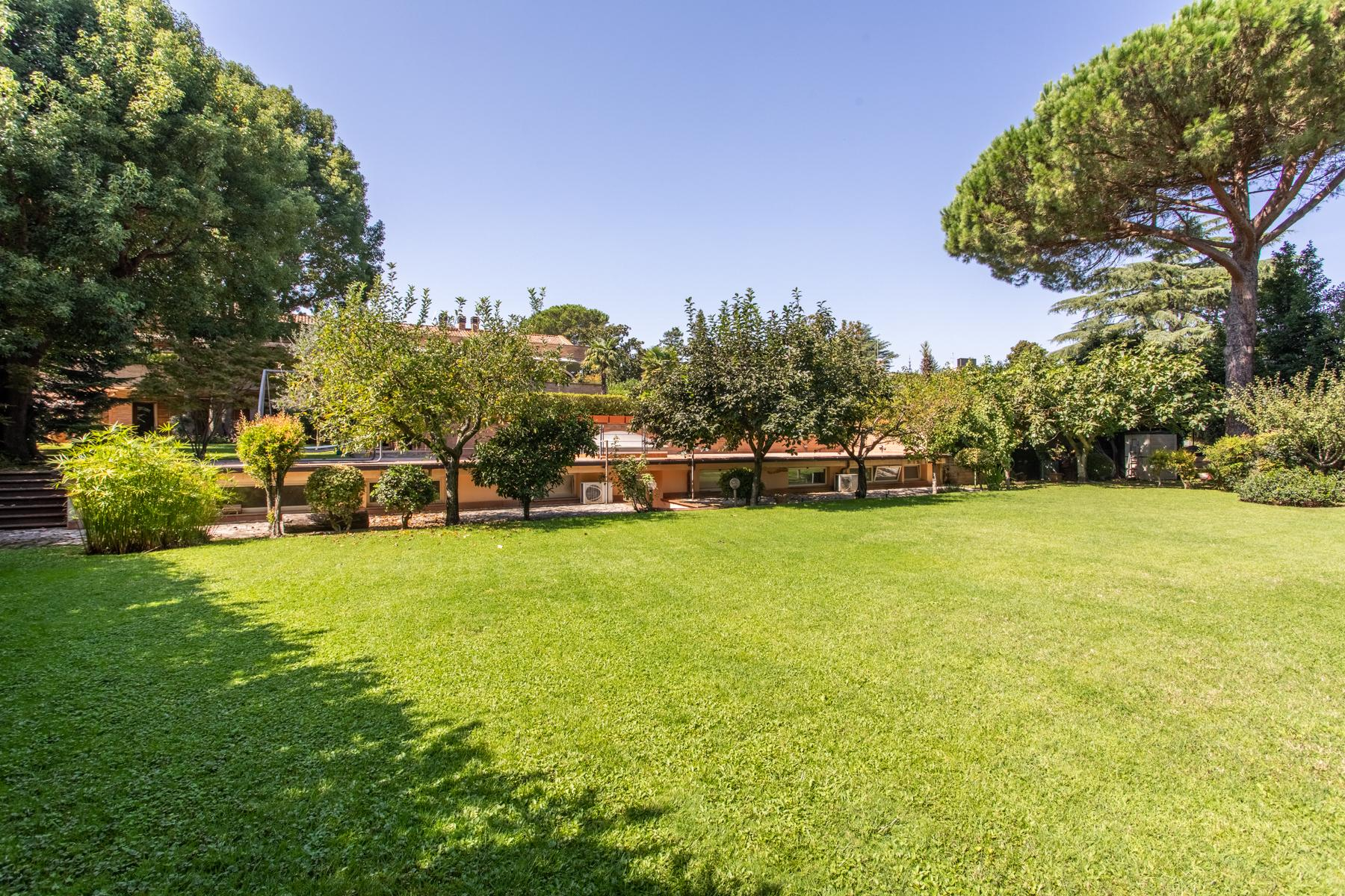 Bright property surrounded by greenery - 13