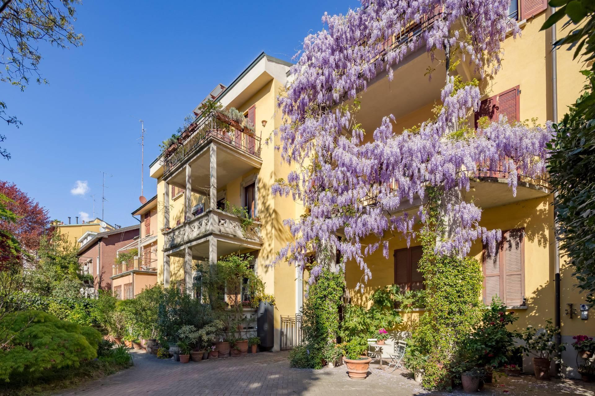 Elegant residence overlooking a lush flower garden - 2