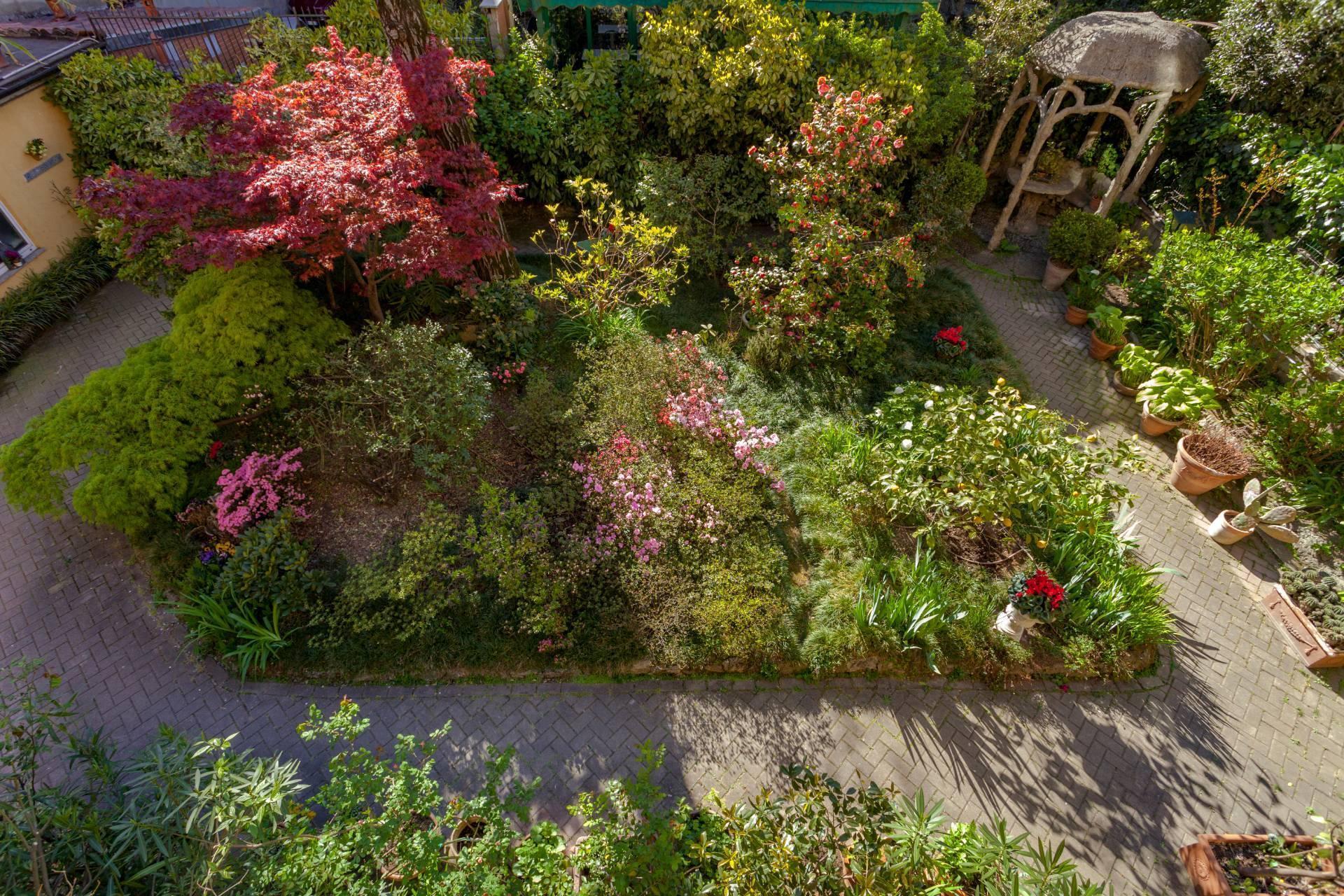 Elegant residence overlooking a lush flower garden - 4