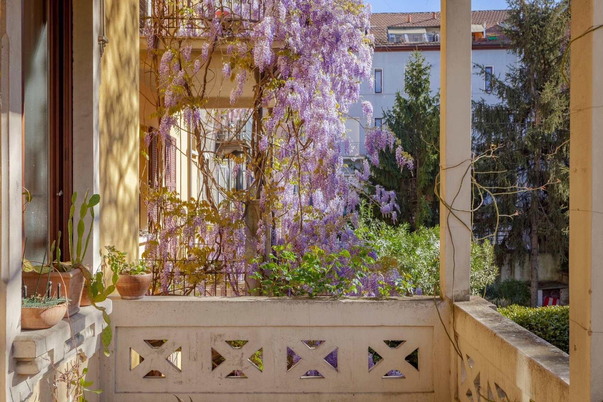 Elegant residence overlooking a lush flower garden - 3