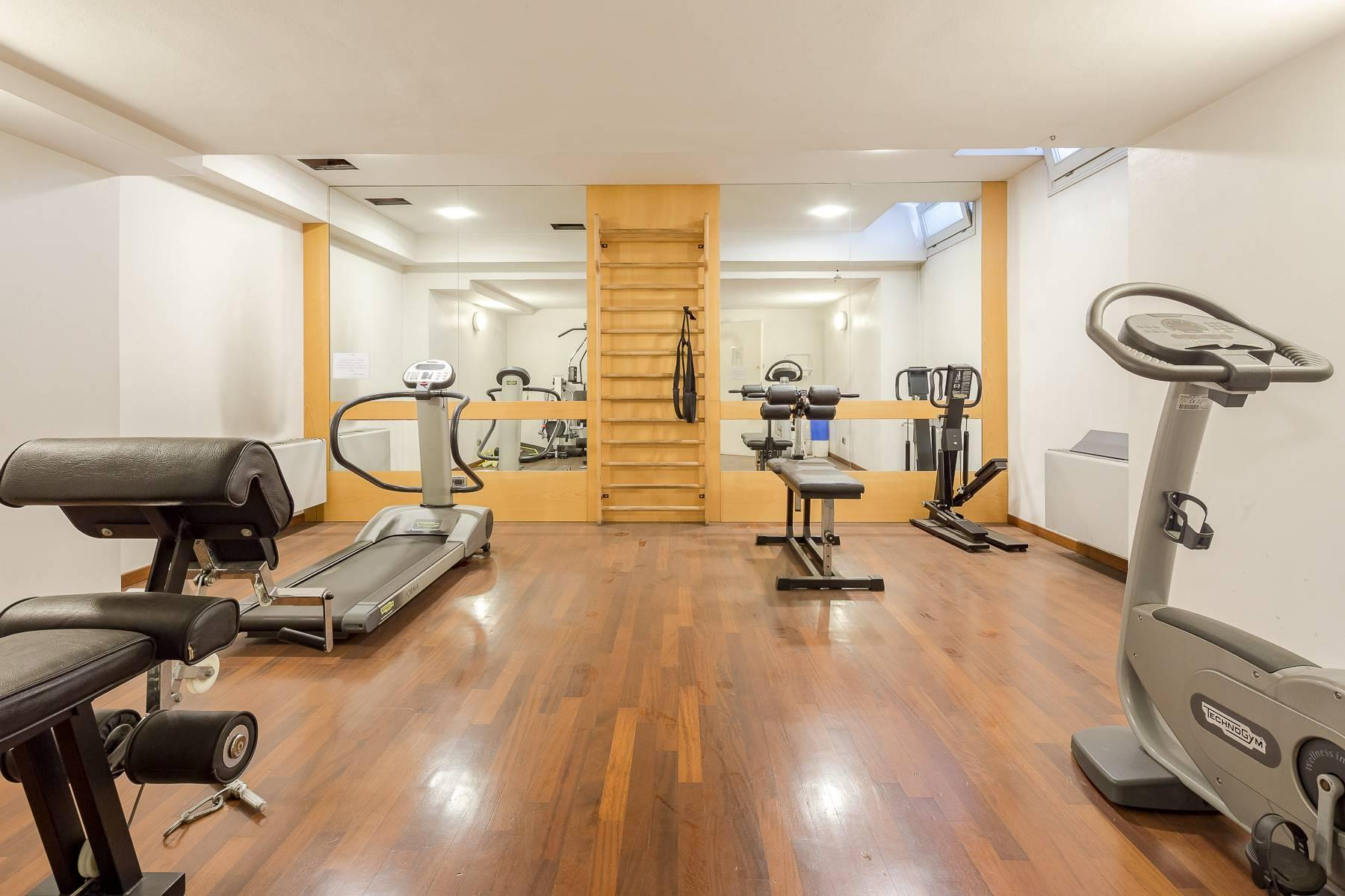 Modern one-bedroom apartment in an elegant building with swimming pool and fitness area - 13