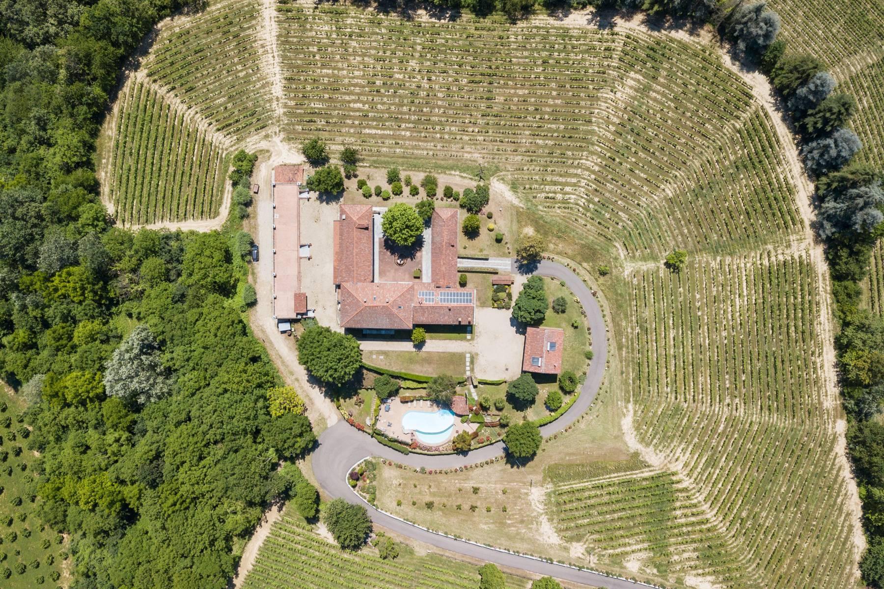 Elegante Villa mit wunderschönem Blick auf die Alpen - 33