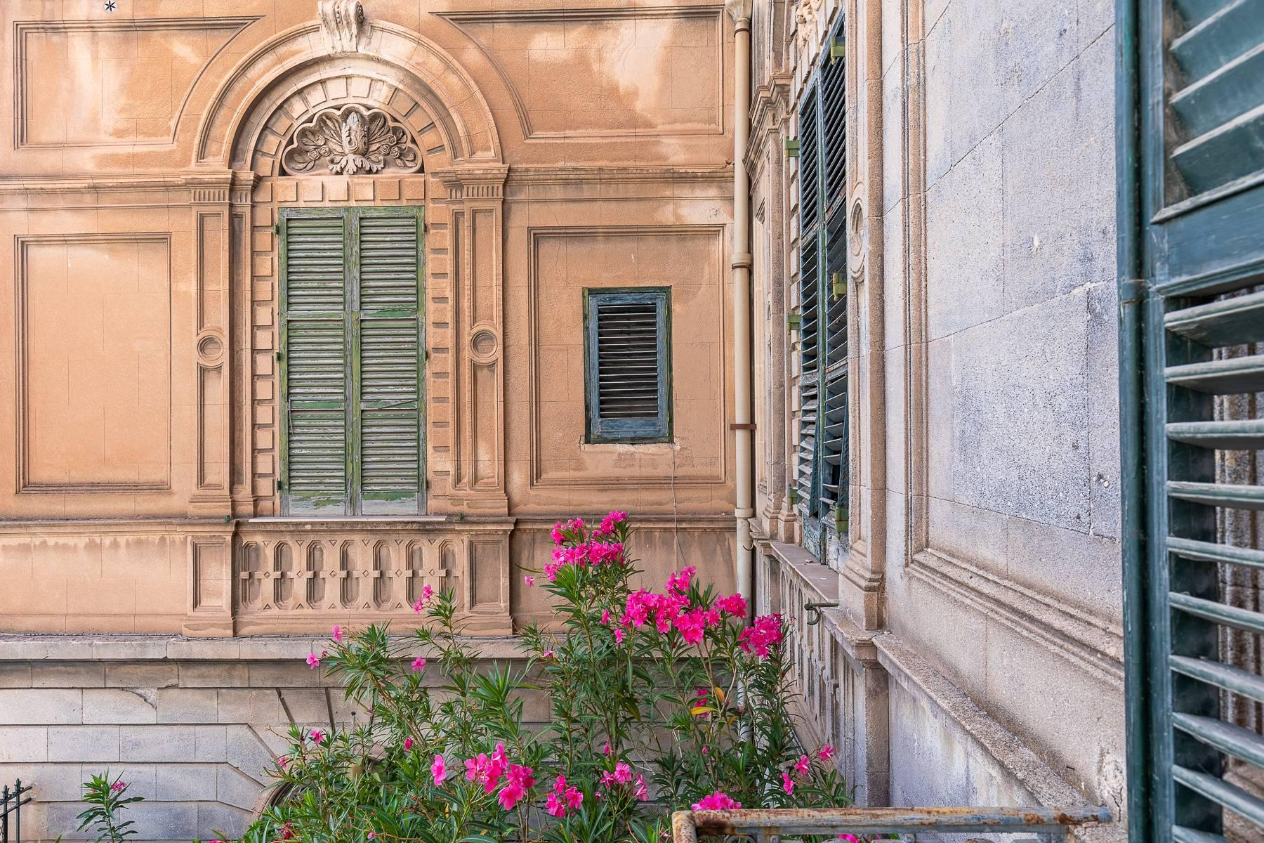 Liberty style building in the historical center of Trapani - 16